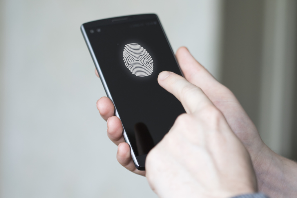 Businessman unlocked phone fingerprint